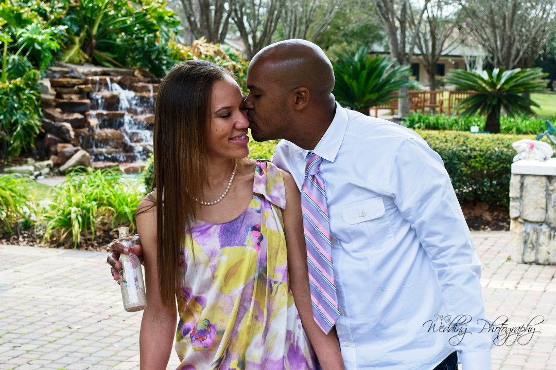 Engagement photos taken whiling the park at Helen's Garden in League City, TX.